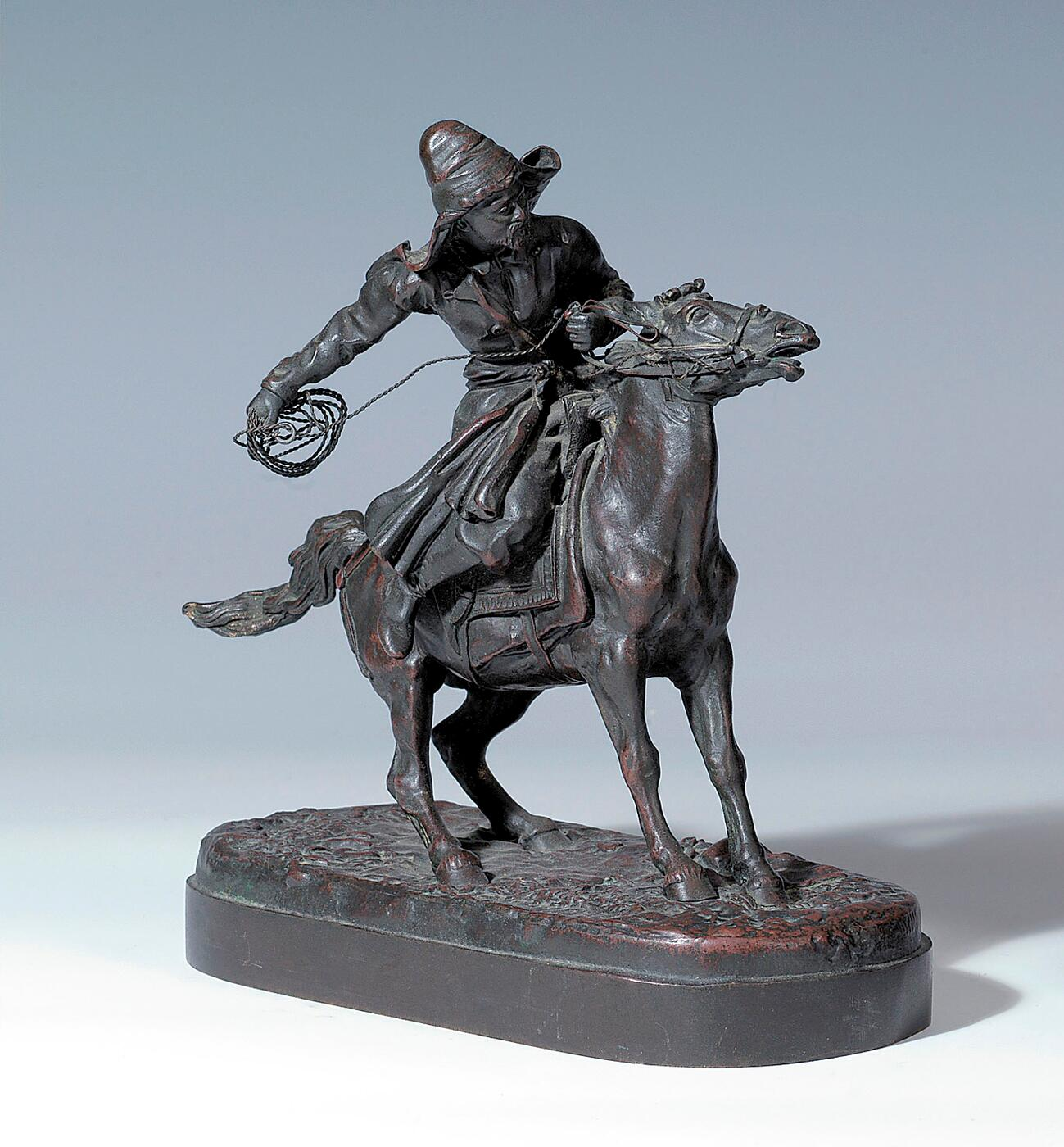 A Bronze Figure of a Horseman