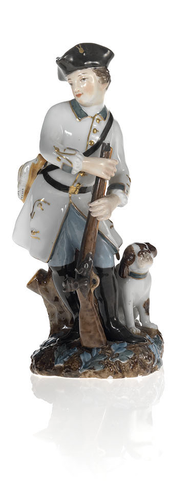 A Porcelain Figurine of a Young Huntsman with His Dog