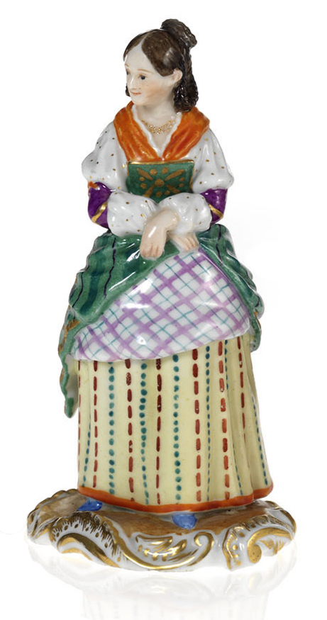 A Porcelain Figurine of an Elegant Maid