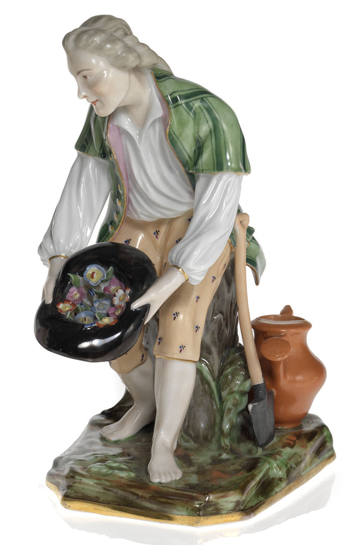 A Porcelain Figurine of a Young Gardener with a Hat Full of Flowers