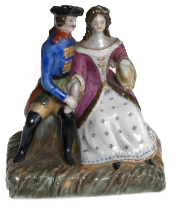 A Miniature Porcelain Figurine of a Couple