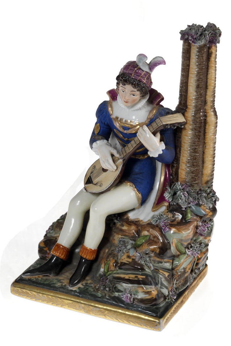 A Porcelain Figurine of a Lute Player