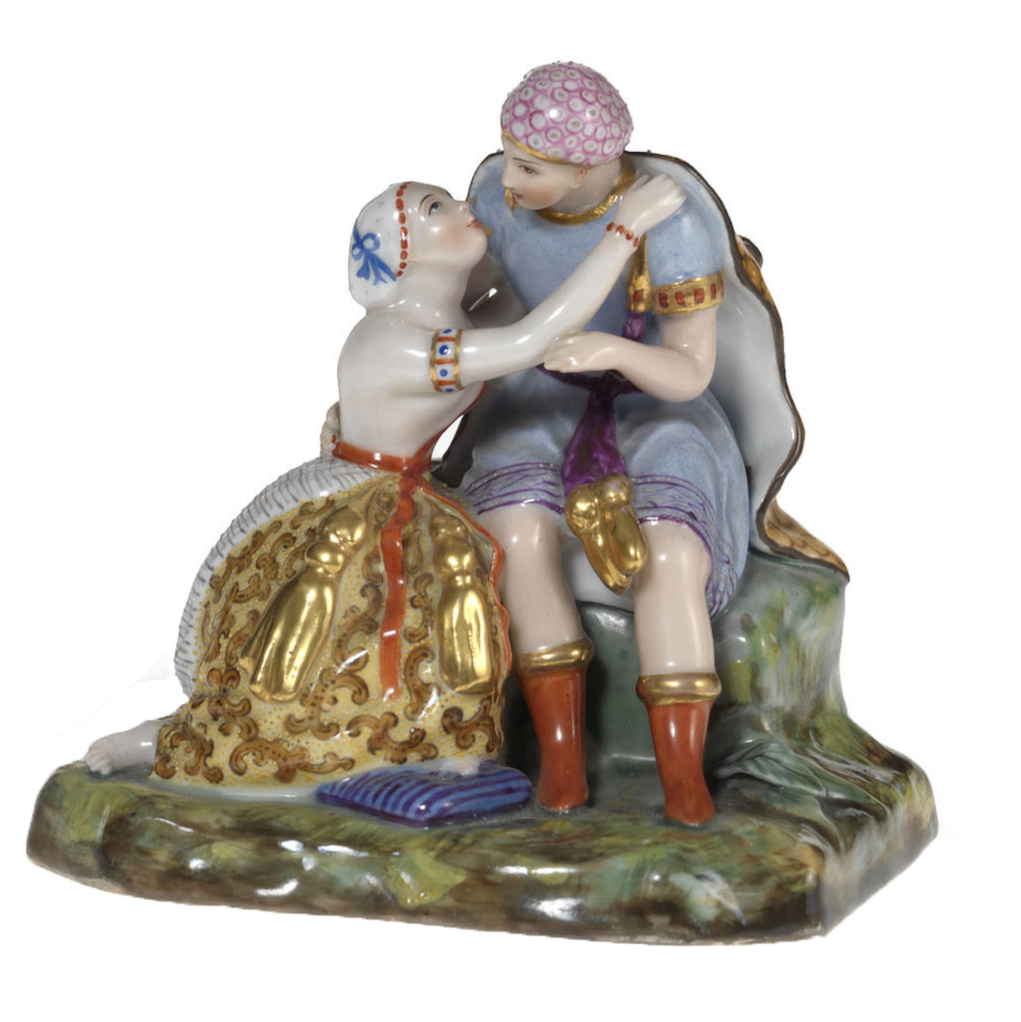 A Porcelain Group of a Couple Embracing
