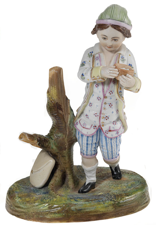 A Biscuit Porcelain Figurine of a Child