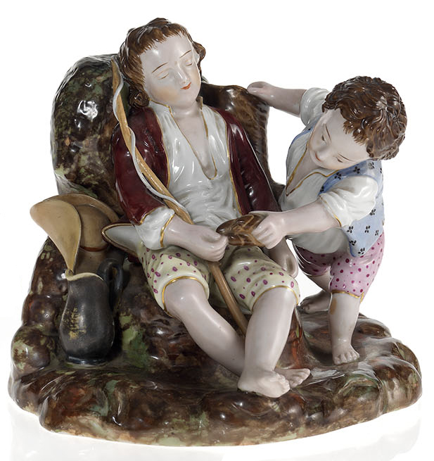 A Porcelain Composition of a Child Teasing a Sleeping Friend