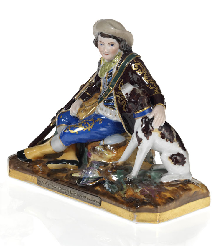 A Porcelain Figurine of a Young Huntsman with a Hound