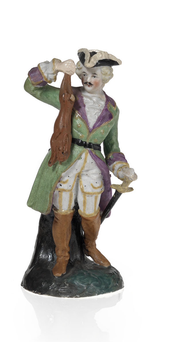 A Biscuit Porcelain Figurine of an 18th Century Huntsman with His Prey