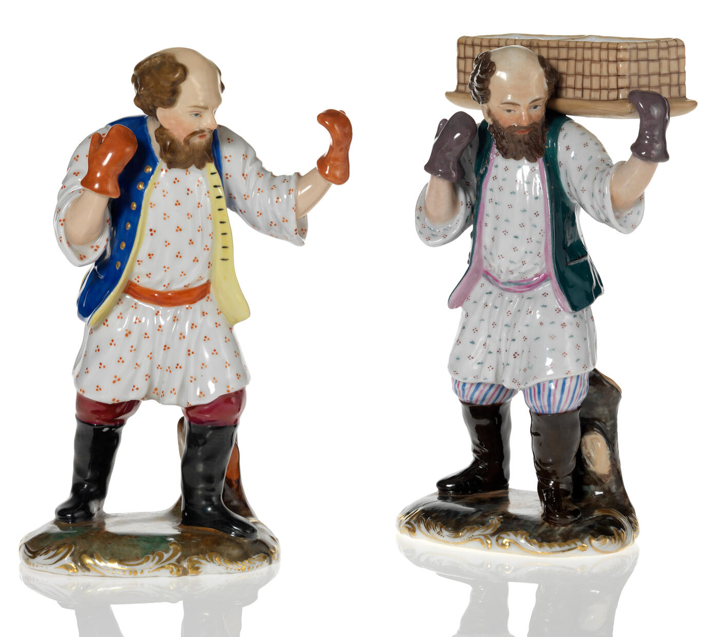 Two Porcelain Figurines of Peasants
