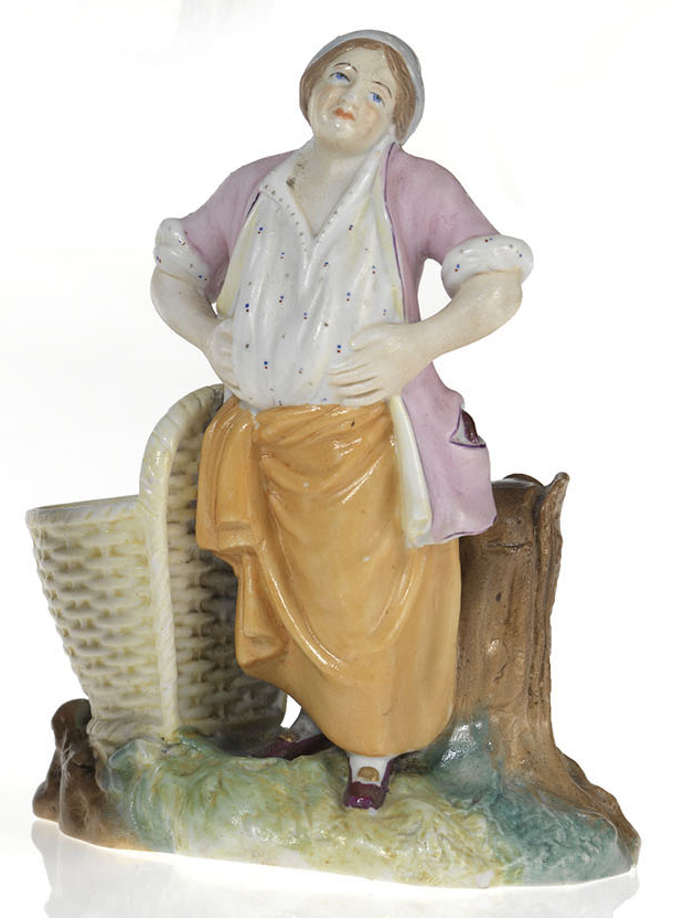 A Biscuit Porcelain Figurine of a Washerwoman