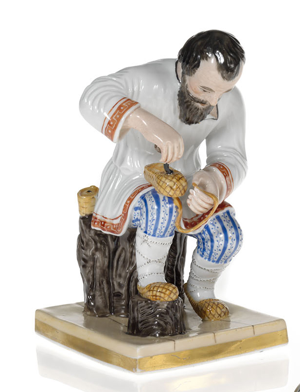 A Porcelain Figurine of a Peasant Making a Bast Shoe