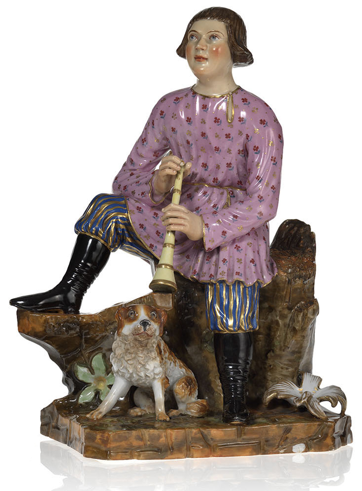 A Porcelain Figurine of a Shepherd Boy Playing His Reed