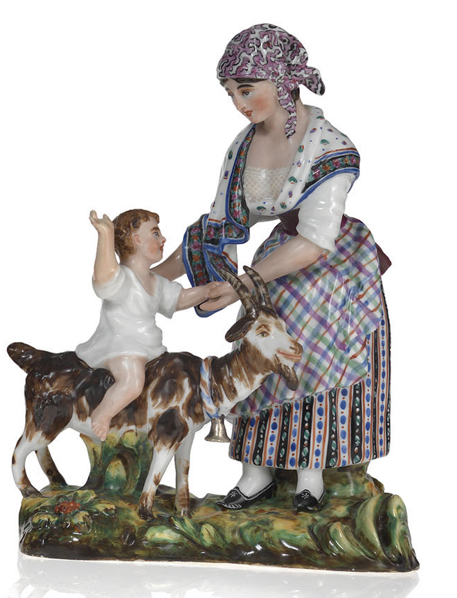 A Porcelain Figurine of a Woman with a Child Riding a Goat