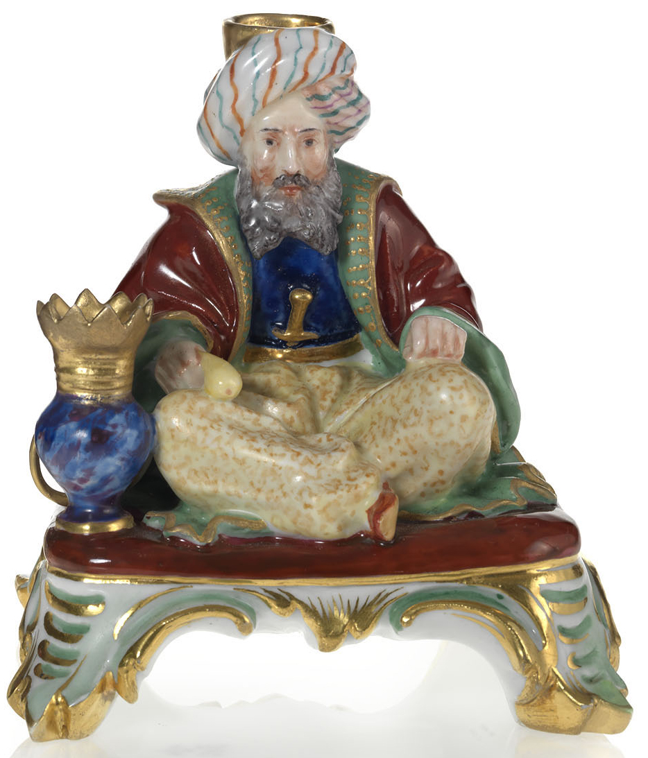A Porcelain Penholder in the Form of a Seated Pipe Smoker