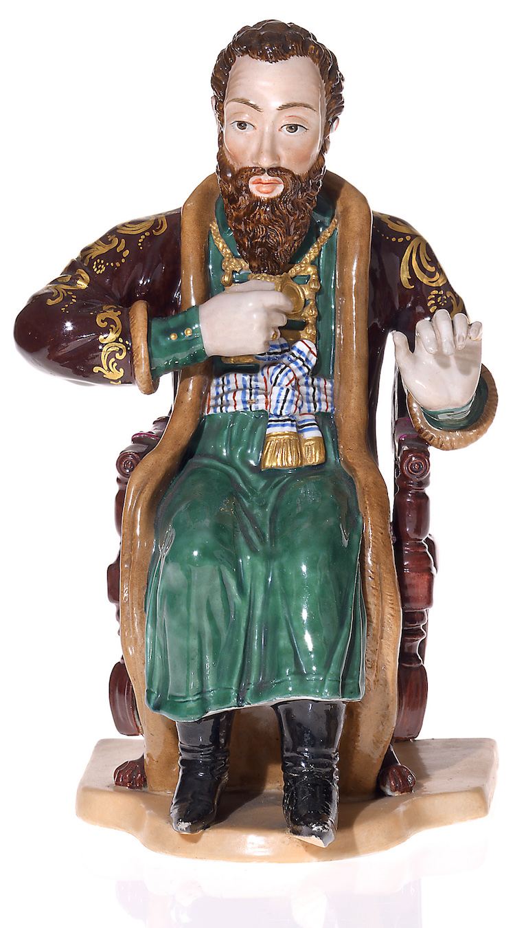A Rare Large Russian Porcelain Figurine of a Draughts Player