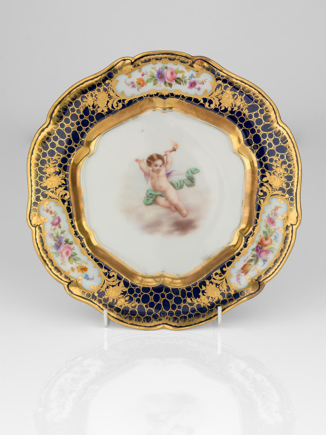 A Porcelain Dessert Plate with Angel Putti
